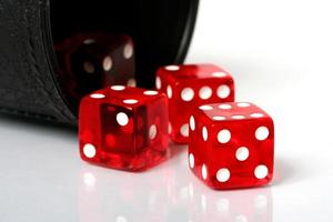 Red dice thrown from cup photo