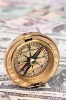 dollar bills and compass