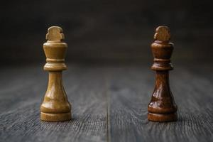 Chess Pieces on a Wooden Table photo