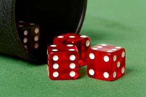 Red dice on felt table photo