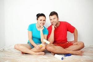 Couple choosing paint color photo