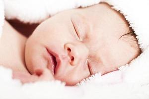 Newborn baby peacefuly sleaping photo