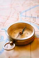 Vintage Compass for Direction Lying on a Map photo