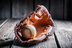 Baseball in a leather glove photo