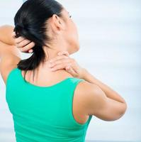 Woman pain in neck photo