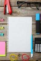 Office supplies on grey wooden background photo