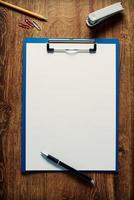 Blank white paper on a clipboard photo