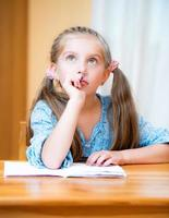 Cute little girl studying