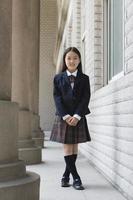 elementary schoolgirl in school uniform photo