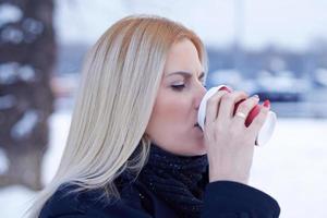 Modern woman drinking caffee photo