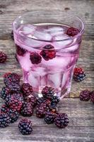 Iced drink with blackberries photo