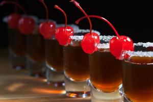 alcoholic drink with cherries photo