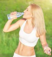 Happy woman drink water photo
