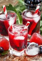 Fresh blackcurrant drink with berries photo