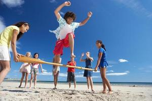 Teenagers having fun on beach photo