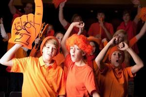Sports Fans: Teenagers Children Enthusiastic Spectators Team Color Orange