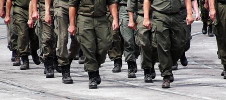 Soldiers marching in formation photo