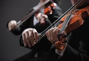 Classical music. Violinists in concert photo