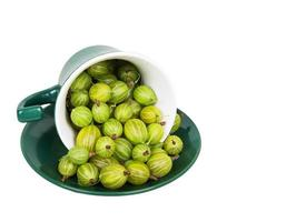 Gooseberries in an inverted green cup photo