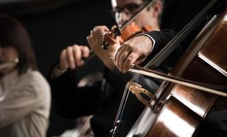 Symphony orchestra: cello player close-up photo