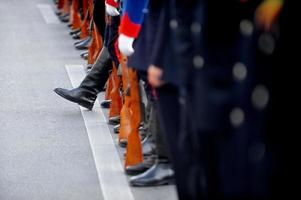 Soldier boot standing out from the line photo