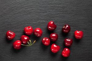 Sweet cherries on slate