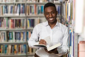 Handsome Young College Student In A Library photo