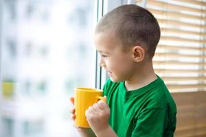 Boy is drinking tea