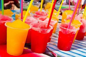 Soft drinks in plastic cups photo