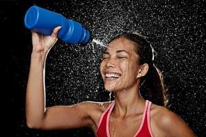 Fitness runner woman drinking photo