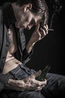 Smoking, beer drinking, depressed man photo