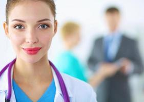 Woman doctor standing with stethoscope at hospital photo