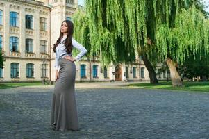 young woman in formal clothes photo