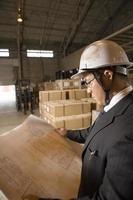 Man checking blueprint photo