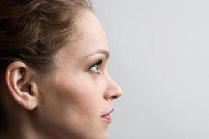 Beauty portrait of young girl in profile with brown hair