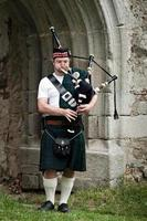 Piping under the Archway photo