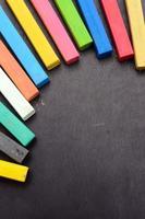 Colorful chalk on blackboard