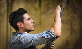 Profile of handsome young man in abandoned building