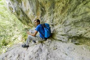 Young man hiking photo