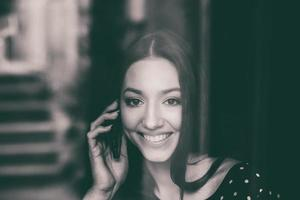 Beautiful girl talking on the phone and smiling photo