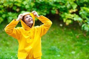 Girl under rain photo