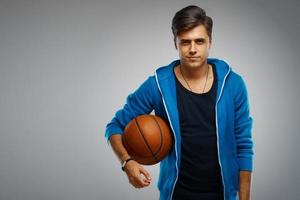 Portrait of a young man basketball player photo