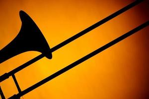 Trombone Silhouette Isolated On Gold photo