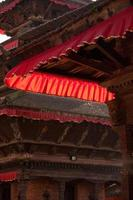 Temple roof detail being lit by sunlight.