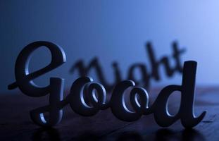 Silhouette of Good Night Sign photo