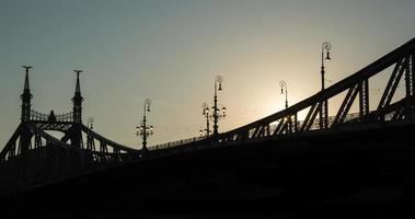 Sunrise above bridge photo