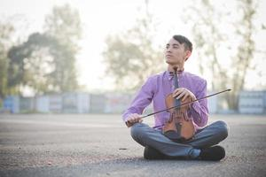 young crazy funny musician violinist asian man photo