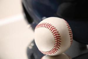Baseball helmet and ball photo