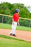 Youth baseball player on third base photo