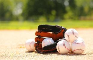 Baseball. Balls and Glove on Field photo